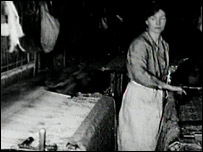 Woman working at a loom (Read about the textiles films we have available for viewing)