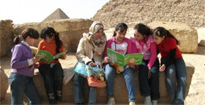 Children from Mostafa Kamel Experimental School, Cairo reading by the pyramids
